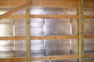 Insulation between the metal and the wood framing.