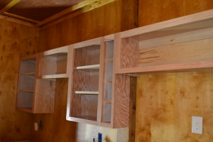 WHAT TO DO IF YOU HAVE A POST IN THE MIDDLE OF THE CABINETS. INSTALL A SPICE CABINET OVER THE POST.